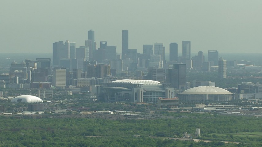 HD stock footage aerial video of NRG Stadium, Houston Astrodome, and the city skyline of Downtown Houston, Texas Aerial Stock Footage | AF0001_000252