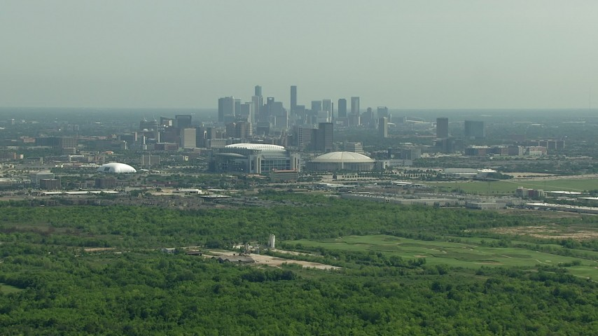 Approach NRG Stadium and Houston Astrodome near the Downtown Houston, Texas skyline Aerial Stock Footage | AF0001_000253