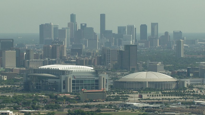Approaching NRG Stadium, Houston Astrodome, and Downtown Houston, Texas Aerial Stock Footage | AF0001_000254