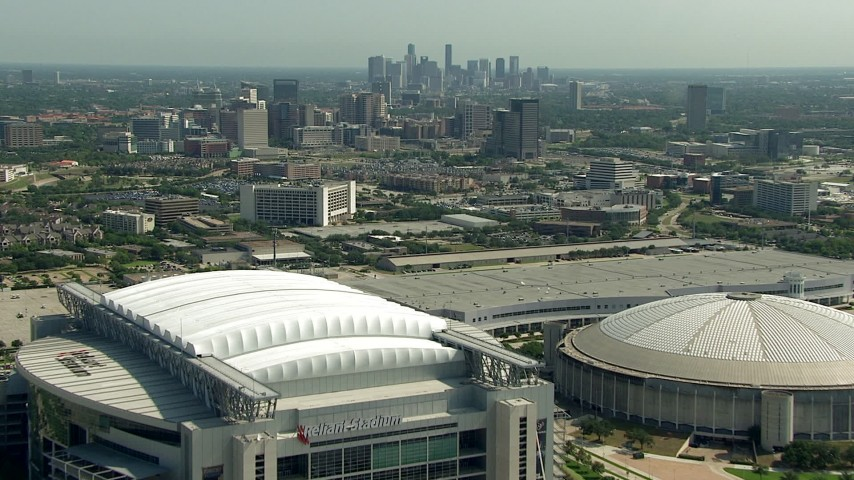 Fly over NRG Stadium and Houston Astrodome near Downtown Houston, Texas Aerial Stock Footage | AF0001_000256
