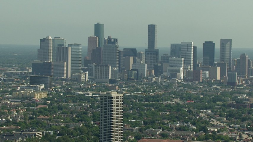 A view of the city skyline, and zoom in closer, Downtown Houston, Texas Aerial Stock Footage | AF0001_000257