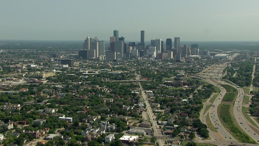 Following Almeda Road to approach the city skyline in Downtown Houston, Texas Aerial Stock Footage | AF0001_000258