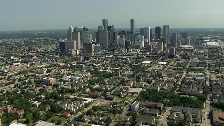 HD stock footage aerial video of a view of the city skyline, and zoom to a closer view, Downtown Houston, Texas Aerial Stock Footage | AF0001_000260