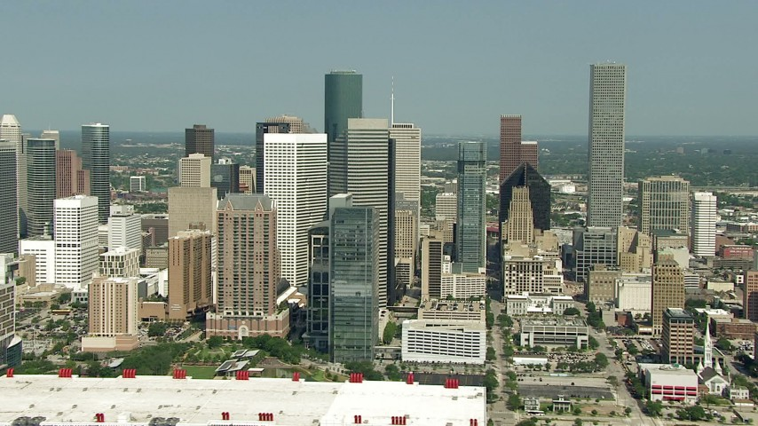 Orbit downtown skyscrapers and reveal Minute Maid Park, Downtown Houston, Texas Aerial Stock Footage | AF0001_000262