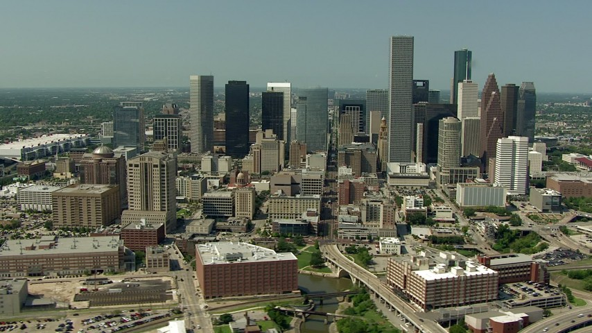 Orbit Harris County Jail Facility, Bakers Street Jail and city skyscrapers  in Downtown Houston, Texas