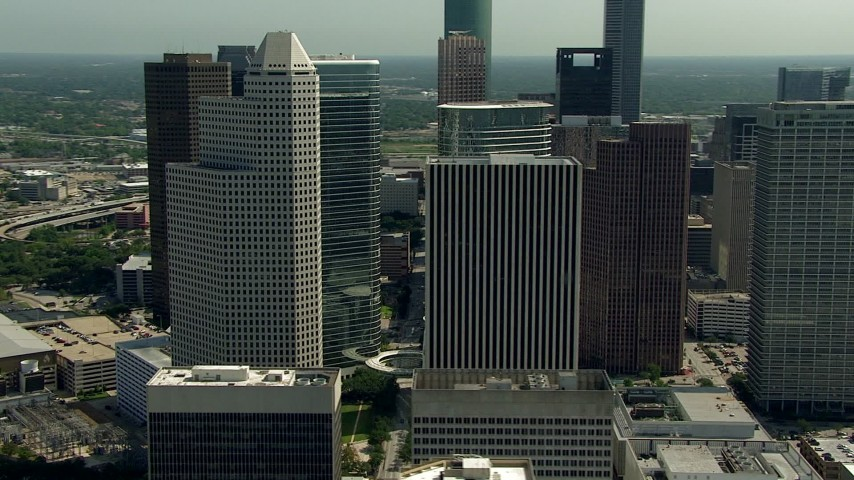 Orbit 1600 Smith Street and nearby skyscrapers in Downtown Houston, Texas Aerial Stock Footage | AF0001_000265