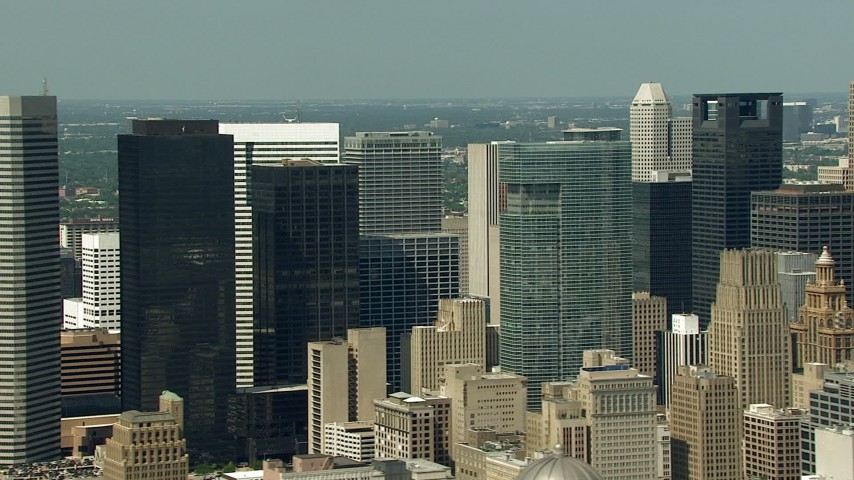 Passing by skyscrapers and high-rises in Downtown Houston, Texas Aerial Stock Footage | AF0001_000269