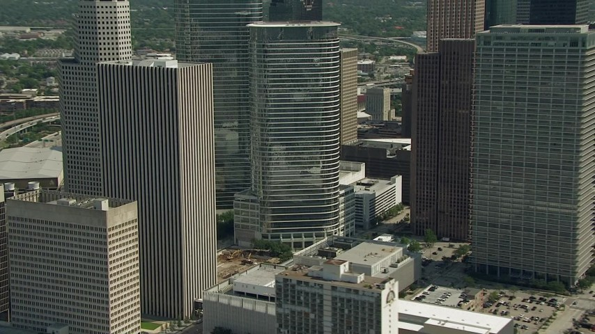 HD stock footage aerial video of flying around Downtown Houston buildings and skyscrapers, Texas Aerial Stock Footage | AF0001_000272