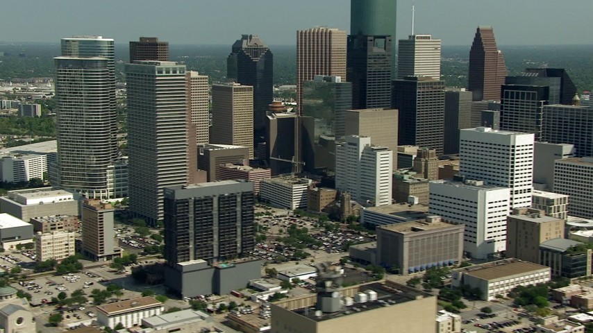 Panning across city skyscrapers in Downtown Houston, Texas Aerial Stock Footage | AF0001_000273