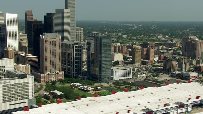 HD stock footage aerial video flyby skyscrapers to reveal the convention center, Minute Maid Park, and the 59 freeway, Downtown Houston, Texas Aerial Stock Footage | AF0001_000274