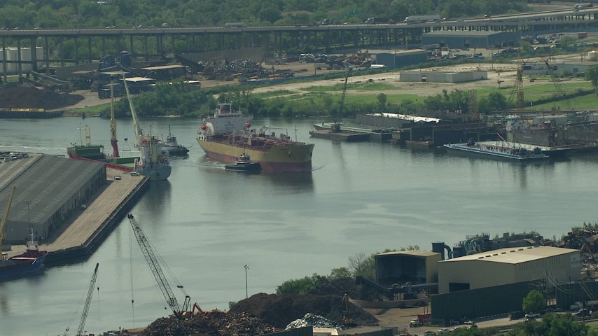 HD stock footage aerial video of tugboats pushing an oil tanker through Buffalo Bayou in Harrisburg, Manchester, Texas Aerial Stock Footage | AF0001_000276