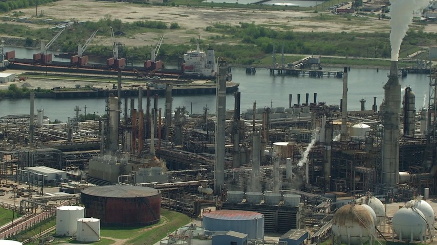 HD stock footage aerial video pan across a riverfront oil refinery in Harrisburg, Manchester, Texas Aerial Stock Footage | AF0001_000280