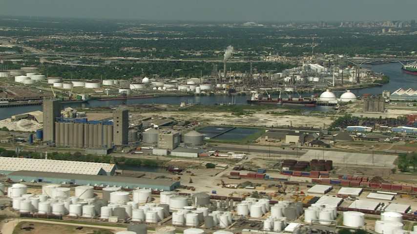 HD stock footage aerial video of flyby an oil tanker and refineries around Buffalo Bayou in Harrisburg, Manchester, Texas Aerial Stock Footage | AF0001_000284