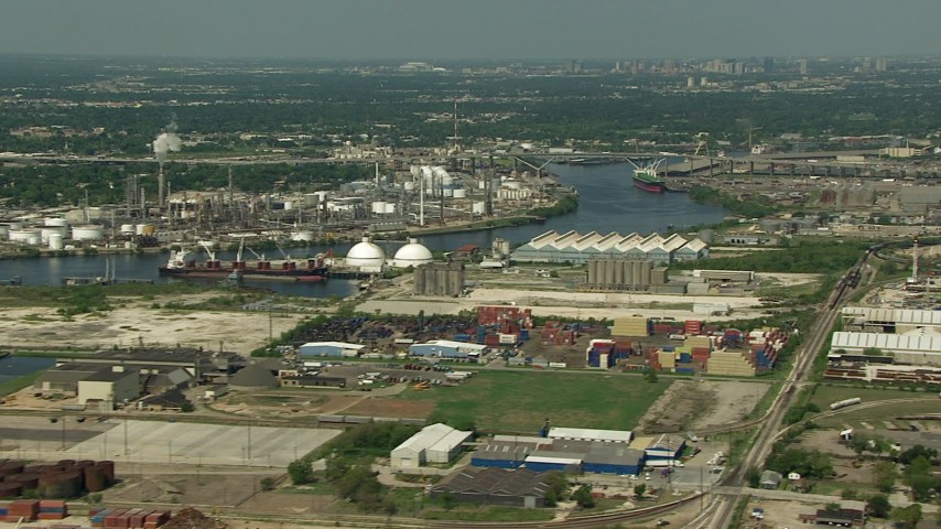 Pan across oil refineries and the 610 Bridge spanning Buffalo Bayou in Galena Park, Texas Aerial Stock Footage | AF0001_000285