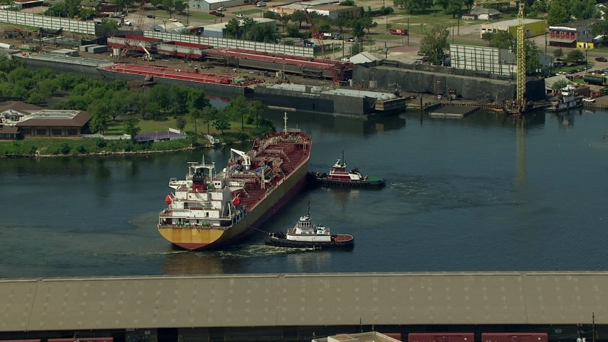 Tugboats turning an oil tanker on Buffalo Bayou in Galena Park, Texas Aerial Stock Footage | AF0001_000286