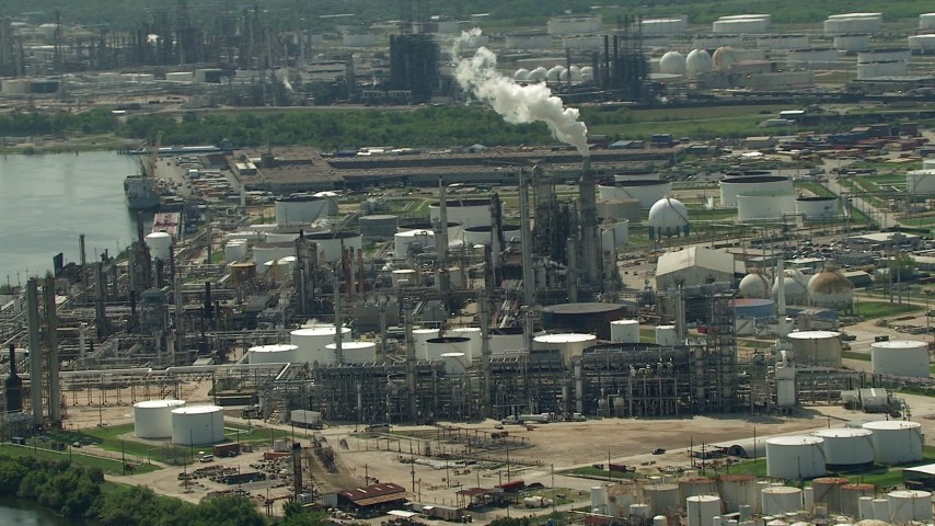 Approach an oil refinery by the river in Galena Park, Texas Aerial Stock Footage AF0001_000287