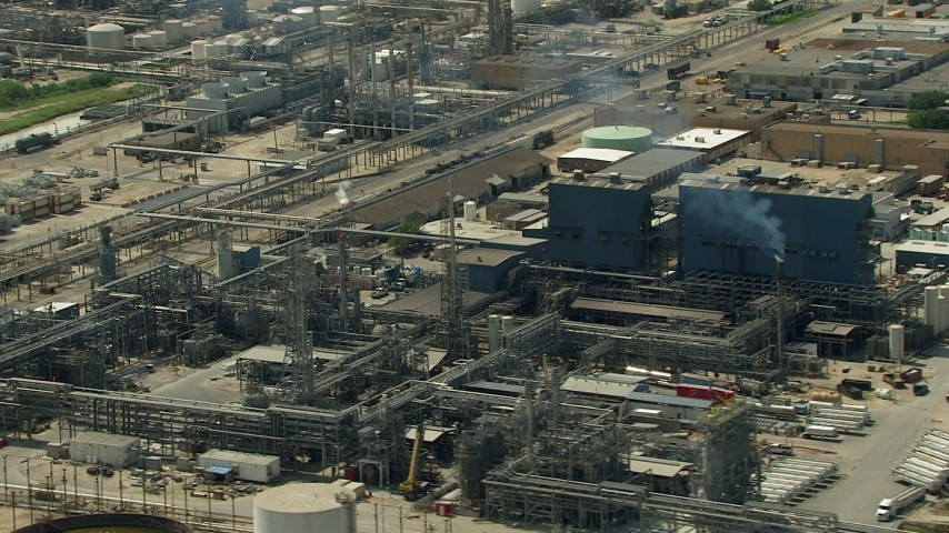 HD stock footage aerial video oil refinery buildings and structures in Pasadena, Texas Aerial Stock Footage | AF0001_000293
