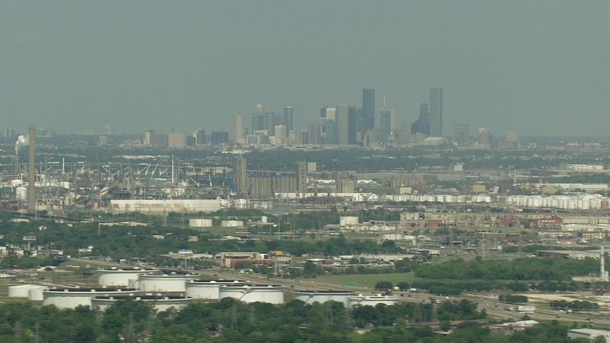 The city skyline seen from oil refineries in Pasadena, Downtown Houston, Texas Aerial Stock Footage | AF0001_000296