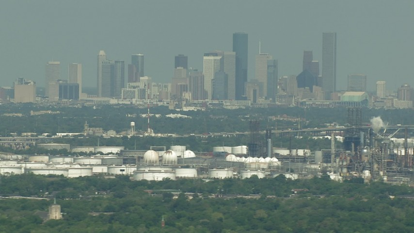 HD stock footage aerial video of Downtown Houston skyline seen from oil refineries in Harrisburg, Manchester, Texas Aerial Stock Footage | AF0001_000297
