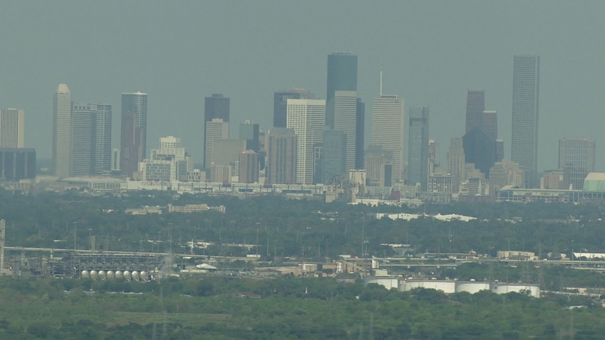 HD stock footage aerial video of a view of the distant skyline of Downtown Houston, Texas Aerial Stock Footage | AF0001_000298
