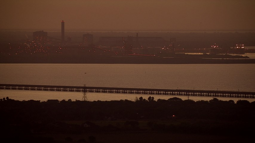 Alcoa Aluminum Plant across Lavaca Bay at sunrise, Point Comfort, Texas Aerial Stock Footage AF0001_000316