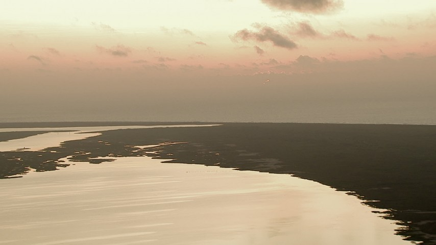 HD stock footage aerial video flyby marshland between the Gulf of Mexico and Espiritu Santo Bay, Texas, sunrise Aerial Stock Footage | AF0001_000335