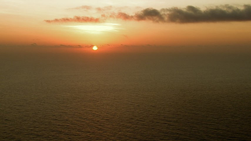 HD stock footage aerial video of a view of the sunrise across the Gulf of Mexico Aerial Stock Footage | AF0001_000340