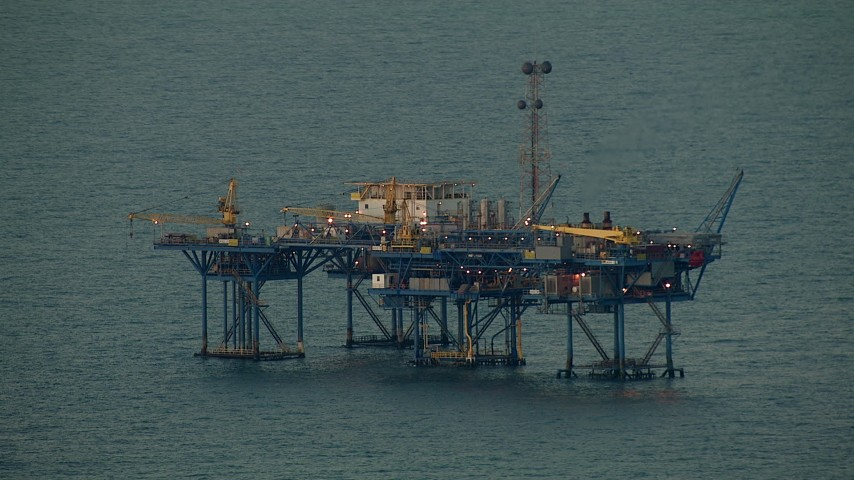 HD stock footage aerial video of an oil rig at sunrise in the Gulf of Mexico Aerial Stock Footage | AF0001_000346