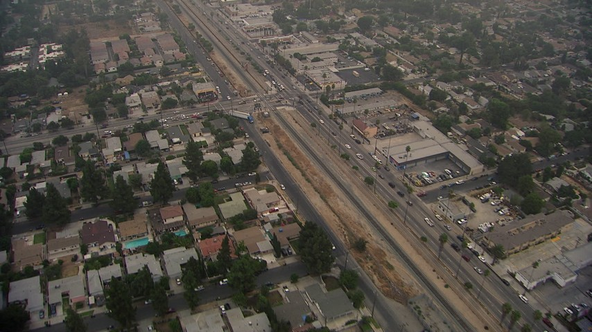HD stock footage aerial video of a reverse view of homes by San Fernando Road in Sylmar, California Aerial Stock Footage | AF0001_000352