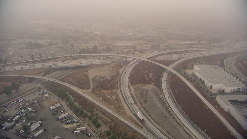 HD stock footage aerial video of the Interstate 5 / 210 Freeway interchange on a fog day, Sylmar, California Aerial Stock Footage | AF0001_000356