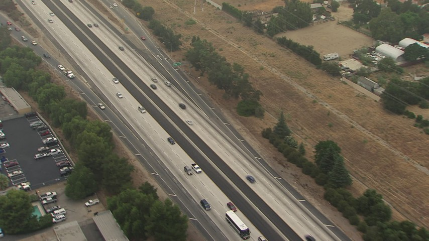 Reverse view of light traffic on the 210 Freeway, Sylmar, California Aerial Stock Footage | AF0001_000359