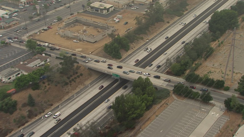 Light traffic on the 210 Freeway, and the Sayre Street and Hubbard Street overpasses, Sylmar, California Aerial Stock Footage | AF0001_000360