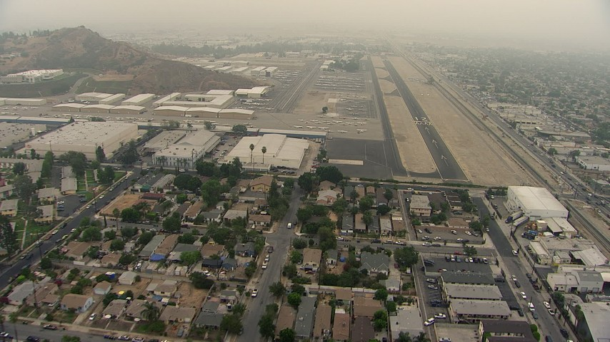 HD stock footage aerial video fly over neighborhoods to approach the runway at Whiteman Airport, Pacoima, California Aerial Stock Footage | AF0001_000365