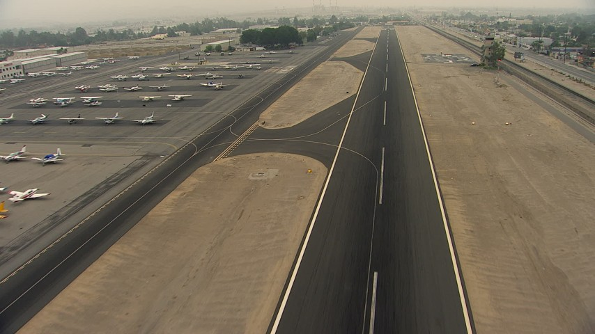 HD stock footage aerial video fly over the airport runway at Whiteman Airport, Pacoima, California Aerial Stock Footage AF0001_000367 | Axiom Images