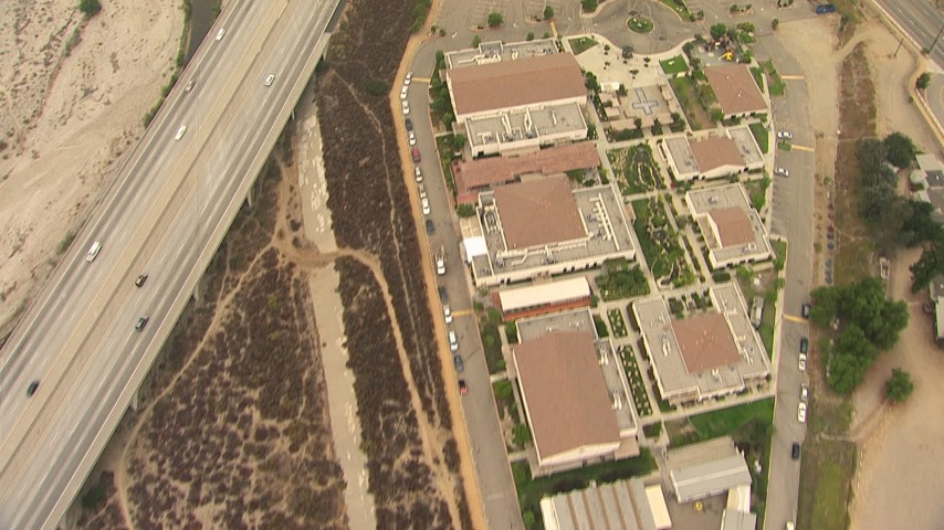 HD stock footage aerial video of bird's eye view of All Nations Church and the 210 Freeway, reveal greenhouses in Lake View Terrace, California Aerial Stock Footage | AF0001_000414