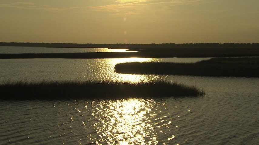 HD stock footage aerial video fly over wetlands and a river reflecting the setting sun, Gulf Coast, Alabama, sunset Aerial Stock Footage | AF0001_000421