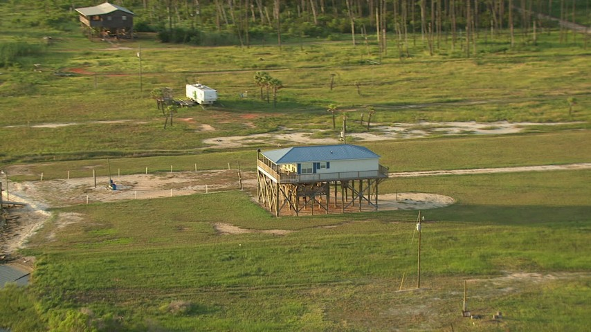 HD stock footage aerial video zoom to a stilt house by a bay in Gulf Coast, Alabama, sunset Aerial Stock Footage | AF0001_000431