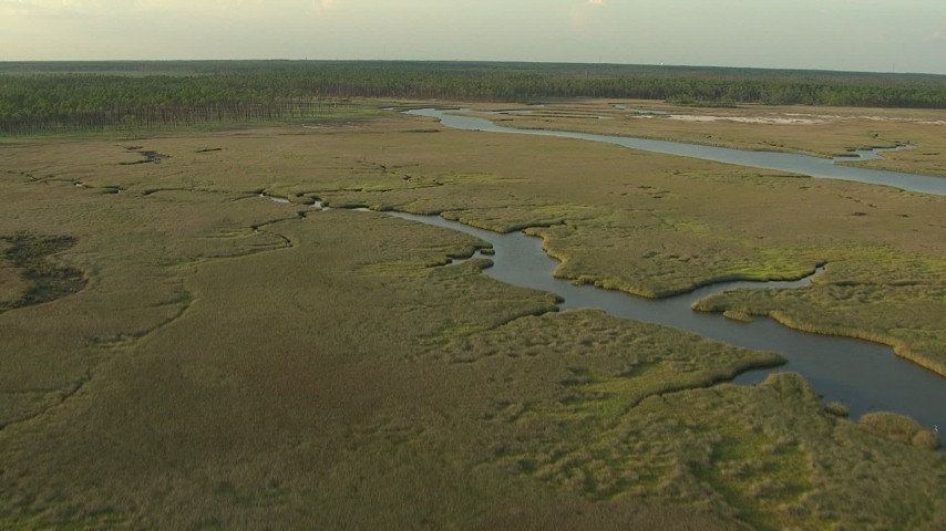 HD stock footage aerial video of flying over wetlands and rivers at sunset on the Gulf Coast, Alabama Aerial Stock Footage | AF0001_000436