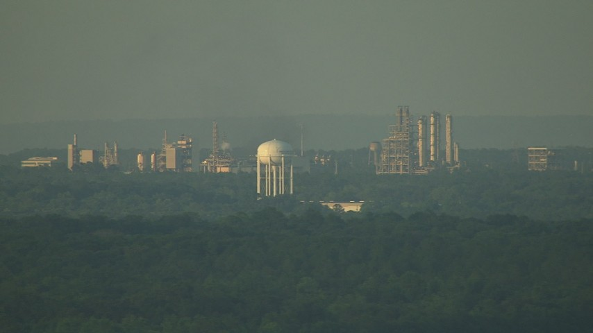 HD stock footage aerial video of water tower and refinery at sunset, pan to reveal factory in the Gulf Coast, Alabama Aerial Stock Footage | AF0001_000445
