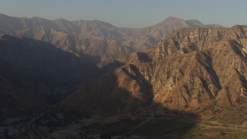 HD stock footage aerial video approach the San Gabriel Mountains, California, sunset Aerial Stock Footage | AF0001_000457