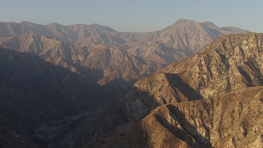 HD stock footage aerial video approach the San Gabriel Mountains, California, sunset Aerial Stock Footage | AF0001_000458