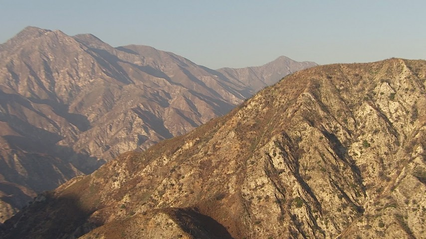 HD stock footage aerial video zoom tighter on a mountain slope, San Gabriel Mountains, California, sunset Aerial Stock Footage   AF0001_000459