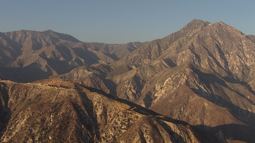 HD stock footage aerial video flyby and pan across San Gabriel Mountains, California, sunset Aerial Stock Footage | AF0001_000460