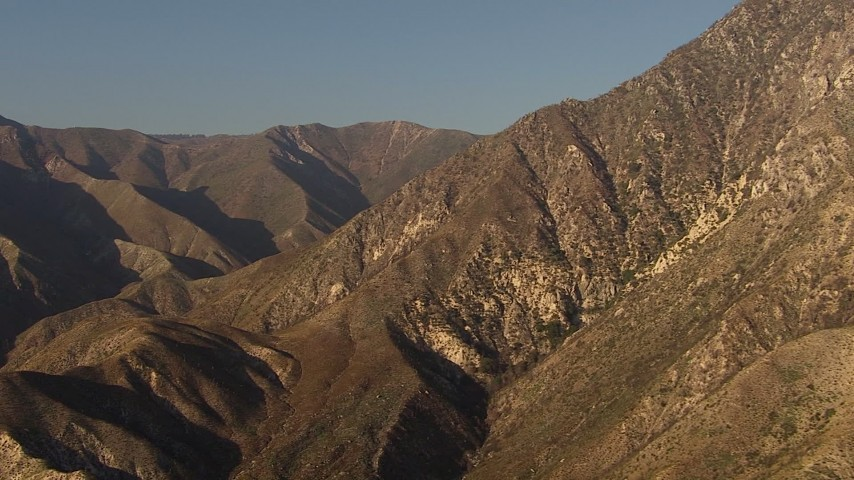 HD stock footage aerial video pan across and approach a peak in the San Gabriel Mountains, California, sunset Aerial Stock Footage | AF0001_000461