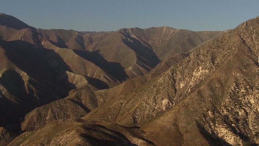 HD stock footage aerial video approach tall mountain ridge in the San Gabriel Mountains, California, sunset Aerial Stock Footage | AF0001_000462