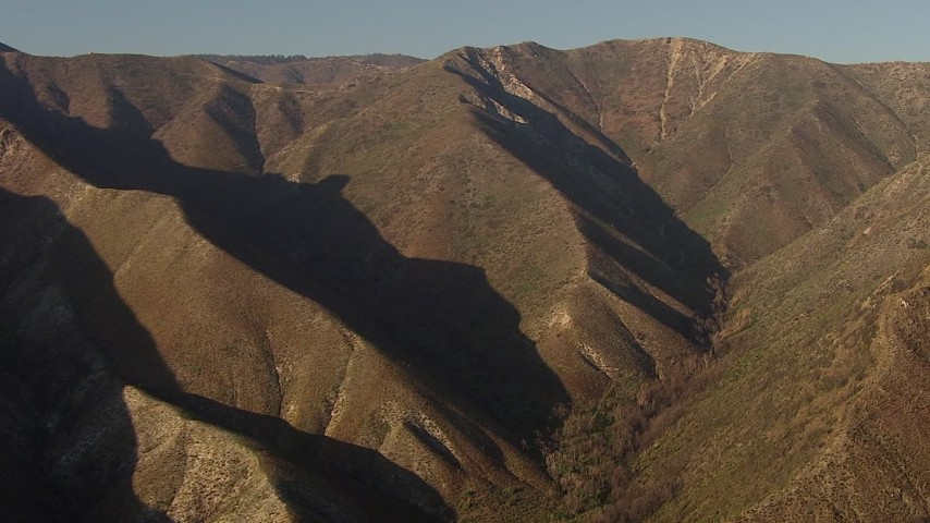 HD stock footage aerial video approach and pan across a steep ridge in the San Gabriel Mountains, California, sunset Aerial Stock Footage | AF0001_000463