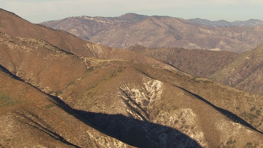 HD stock footage aerial video pass and pan across a peak in the San Gabriel Mountains, California, sunset Aerial Stock Footage | AF0001_000465