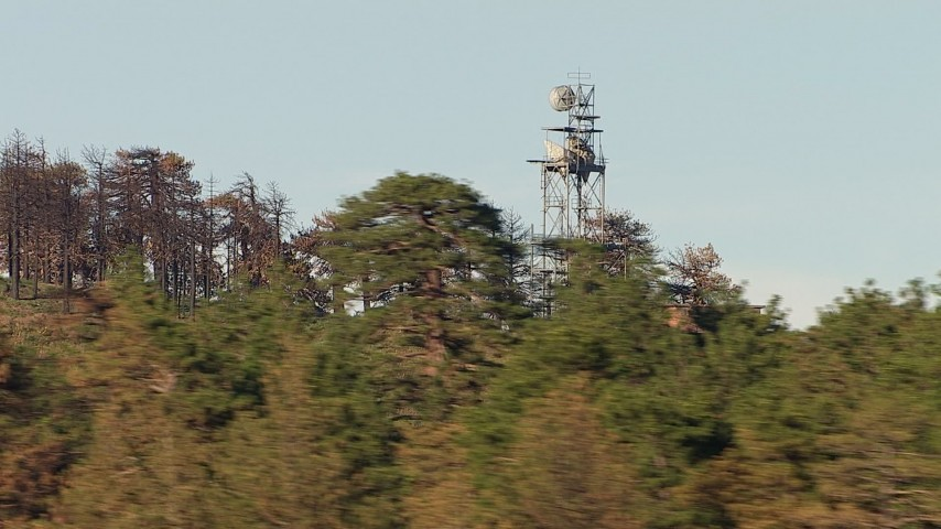 HD stock footage aerial video flyby trees to focus on a transmission tower, San Gabriel Mountains, California Aerial Stock Footage | AF0001_000468