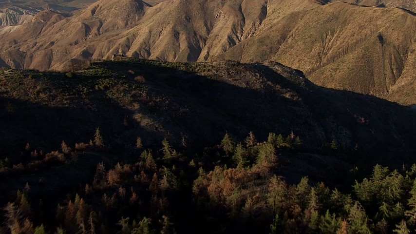 HD stock footage aerial video fly over a ridge to reveal a wider view of San Gabriel Mountains, California Aerial Stock Footage | AF0001_000470