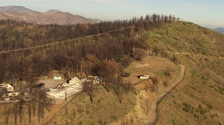 HD stock footage aerial video of abandoned buildings and power lines on a ridge in the San Gabriel Mountains, California Aerial Stock Footage | AF0001_000471